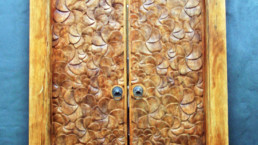wooden door with flower patterns