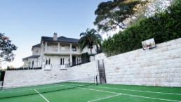 stonework around tennis court
