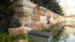 Close up of Natural Pool stone wall detail and natural pool edge.