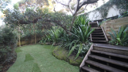 view of garden with wooden staircase landscaping