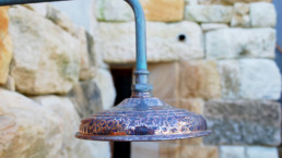 Close-up of outdoor shower head with pattern
