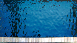 Freshwater pool reflection and part of decking